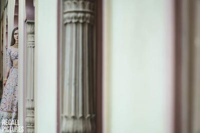 Unique bridal shot behind the pillars