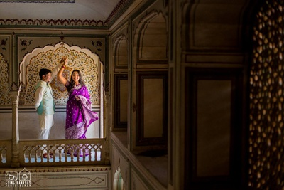 Bright aubergine and silver saree, a great pre wedding shoot outfit idea