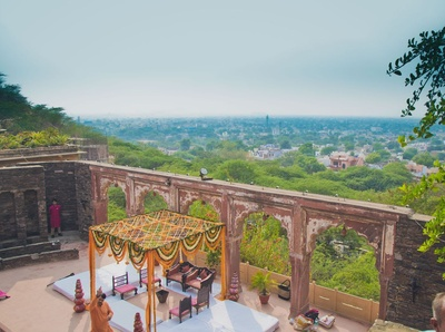 A shot from the ancient stairs of amphi theatre and an open air vedi mandap decorated with Marigold strings