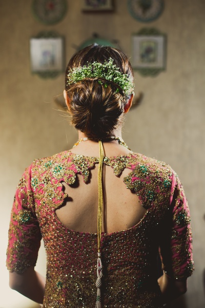 This bride has donned an offbeat back design blouse which is a must-see