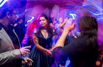 A candid picture of the bride dancing at her cocktail party