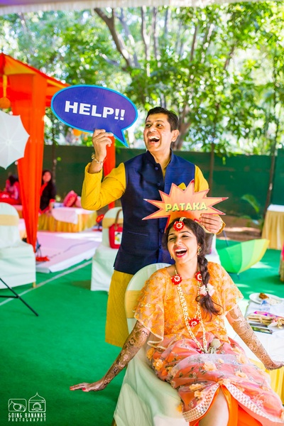 Apurva dressed in a floral chiffon self designed maxi dress for her outdoor mehendi ceremony held at Taj Deccan, Hyderabad