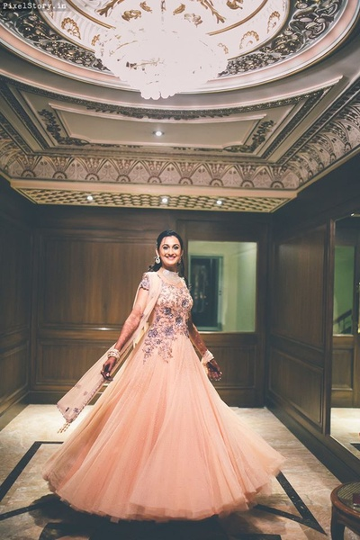 Dressed up in peach coloured gown with grey and silver embroidery by Dolly J, Delhi