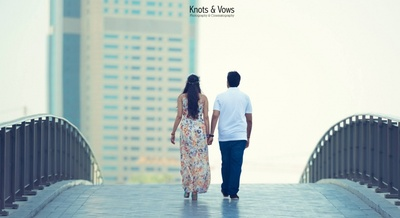Dressed in a floral maxi and casual white T-shirt and trousers for destination pre wedding photo shoot at Dubai