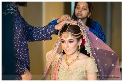 Blush pink and gold wedding lehenga styled with gold necklace set and radiant makeup by Guru Singh, Delhi