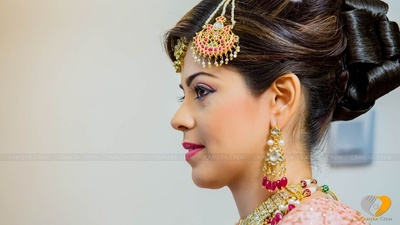Kundan and stone chandelier earrings and a jhumar