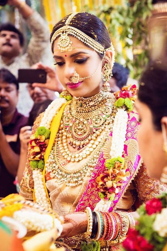 a09352f48a This stunning bride right here tells us that you don't have to follow any  rules when it comes to your bridal look. Who says you can't rock a pattu  saree ...