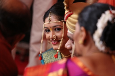 Dressed in traditional attire, complementing with delicate Maharashtrian jewellery