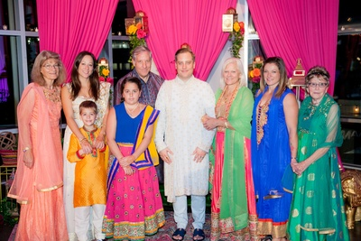 Martin and his family dressed in Indian attire for the sangeet/garba night