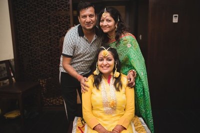 Dressed up in a bright yellow and silver gota patti work salwar suit paired with yellow floral jewellery for the haldi ceremony.