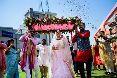 the bride making an entry under phoolon ki chadaar