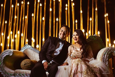 The bride and groom share a cute and funny moment at their sangeet ceremony!
