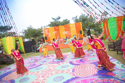 Regional artists performing dressed in ethnic Indian outfits