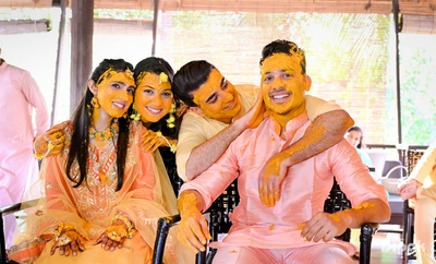 Two brides and to grooms in one frame at their haldi ceremony!