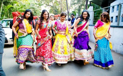 Wedding guests dressed in colorful lehengas for the wedding ceremonies