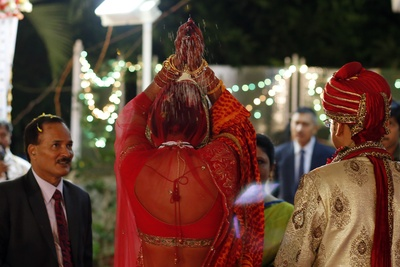 Bride executing traditional Indian wedding rituals
