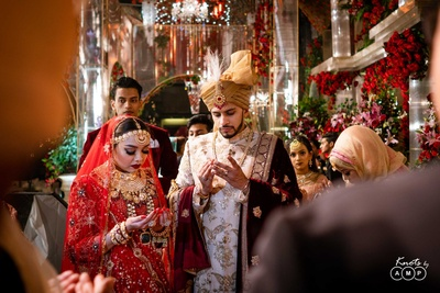 The bride and groom seeking the Almighty's blessings during their wedding.