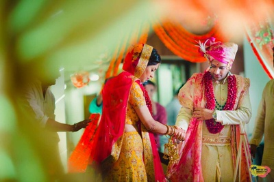 Candid click of bride and groom during the pheras