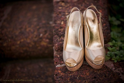 Gold peep-toe heels to be styled with the wedding lehenga  by Jimmy Choo