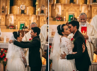 Dressed in a sheer embellished low back bridal dress and groom dressed in a black suit for the wedding ceremony in a red and white color thene