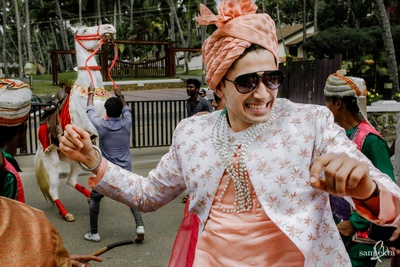 candid capture of the groom dancing at his baraat