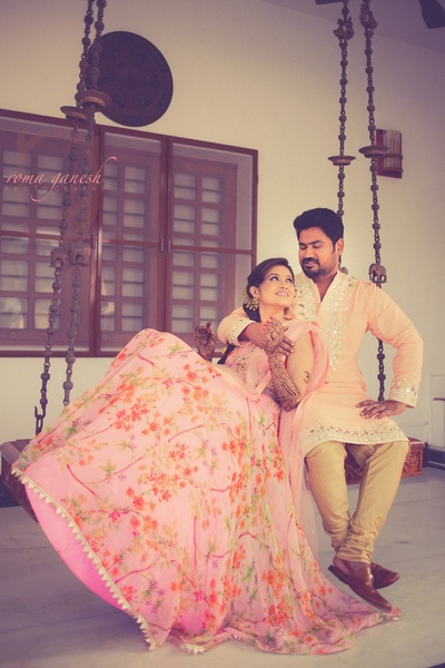 candid couple photography with the bride in floral lehenga