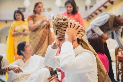 Wearing pure white pajama kurta and beige turban for the pre wedding rituals.