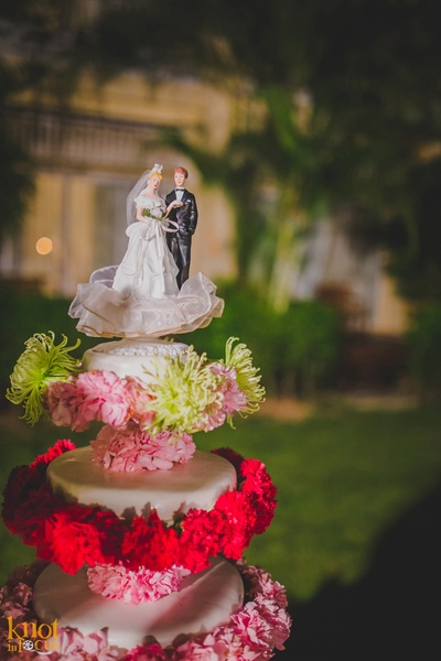 Five tier wedding cake decorated with fresh flowers