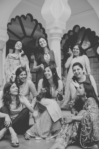 Candid black and white bridesmaids photography by Photozaapki.