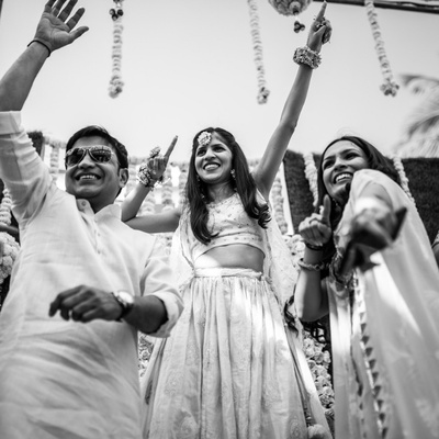 A candid moment capturing all the fun that went down at the Mehendi ceremony.