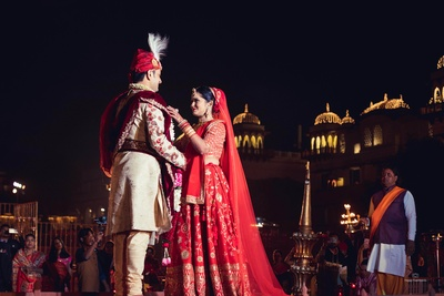 A stunning jaimala moment between the bride and groom at the wedding!