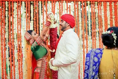 Genda flowers and Tube roses strings suspended across the Vedi Mandap