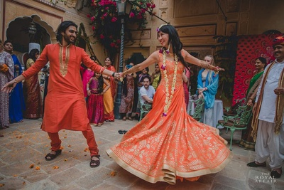 Bride and groom dancing to their mehendi celebrations.