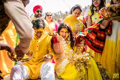 The couple having the time of their life at the haldi ceremony.