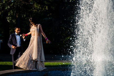 cute couple shot by the fountain