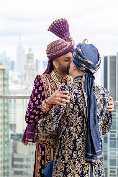 the grooms kissing passionately during the  wedding photoshoot