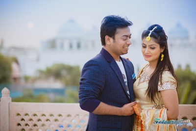 Navy blue suede jacket with textures for their prewedding photo shoot at Jagmandir, Udaipur
