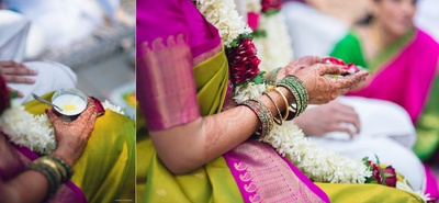 Goan bride in green and red bangles with natural flower white and red varmala