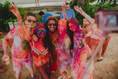 Painted and drenched in vibrant colors for the Holi celebrations.