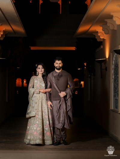 Bride and Groom in a beautiful trousseau for their Sangeet ceremony
