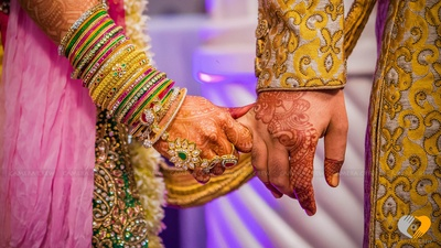 Bride groom wearing yellow and pink for their wedding ceremonies
