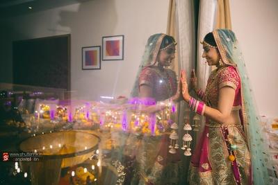 Pink and aqua wedding lehenga be dazzled with resham embroidery, thread work motifs, gota patti work, pom-poms and intricate detailing