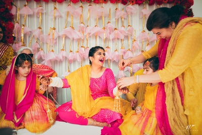 Pink and yellow theme colour for haldi ceremony and kaleere ceremony.