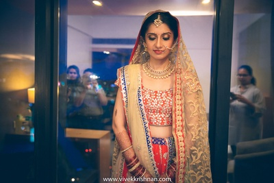 Coral and navy blue bridal lehenga embellished with gota patti and styled with two dupattas