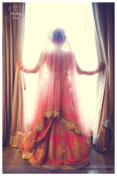 Pink flared wedding lehenga styled with woven motifs and matching double dupatta