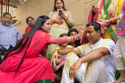 Traditional Indian haldi ceremony being held for the groom