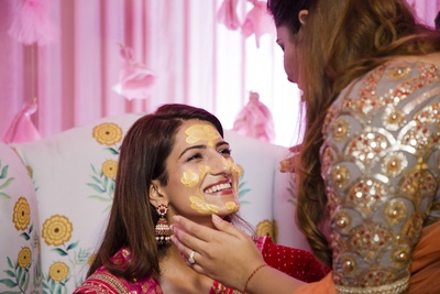 This adorable bride enjoys a moment at her haldi ceremony!