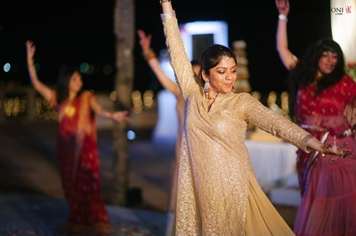 Beige and gold outfit worn by a guest - Sangeet outfit inspiration