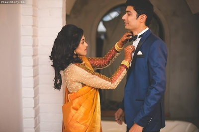Megha in mustard color saree and Shravan complementing her in this navy blue suit with black bow!