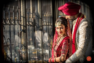 The couple posing after their Sikh wedding